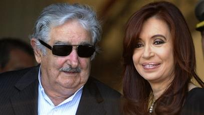 Tell us you really feel, José -   Hot mike catches Uruguayan President taunting Fernandez de Kirchner