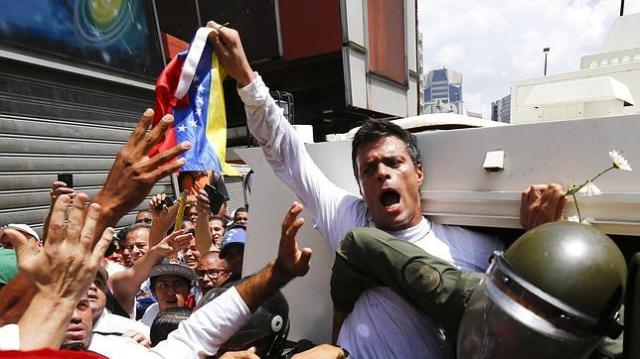 "Leopoldo López turns himself in accompanied by a crowd of supporters. ""If my arrest helps the people to wake up, it will be worth it"", he said."